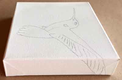 Draw the hummingbird and carry it over the edge of the gallery-wrap canvas.