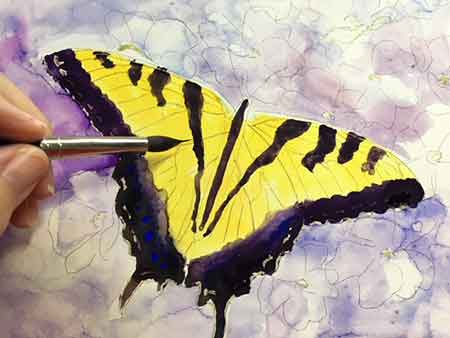 Lightly paint the black veins in the butterfly wings.